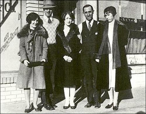 Walt + Roy Disney pose in front of the Kingswell Studio with wives+friend
