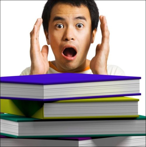 Man Looking At Books Shows Education