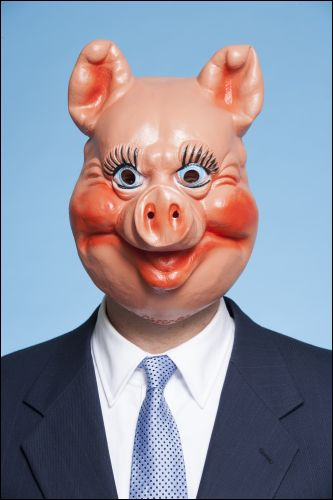 Businessman with pig mask